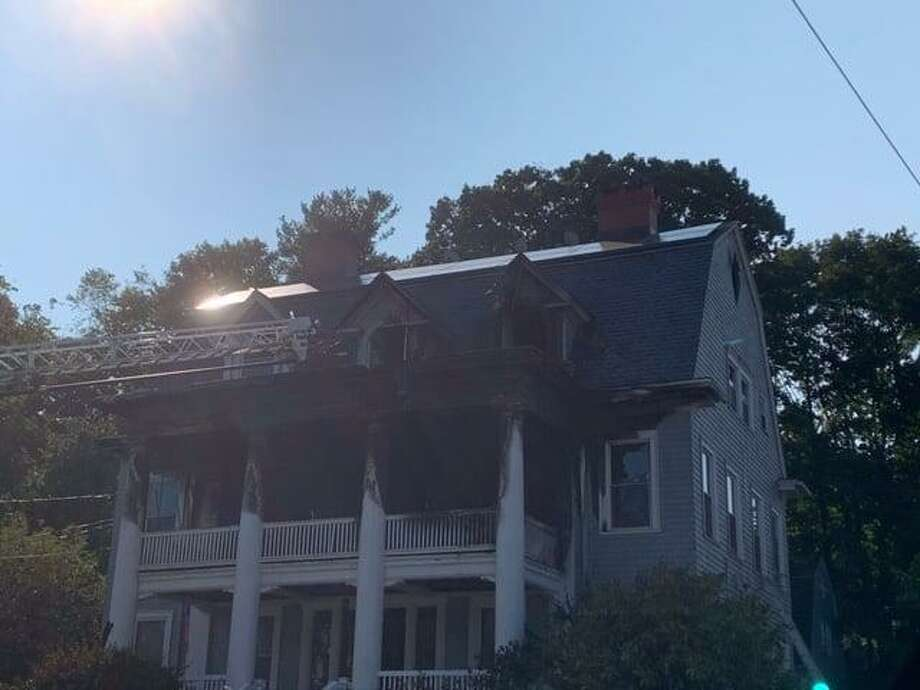 A three-story home from 1907 was damaged Monday, Sept. 21 on Hillside Avenue in Naugatuck after a fire that began on the second-floor spread to the main house and third floor. Two people were displaced by the blaze. Photo: Contributed /Naugatuck Fire Department