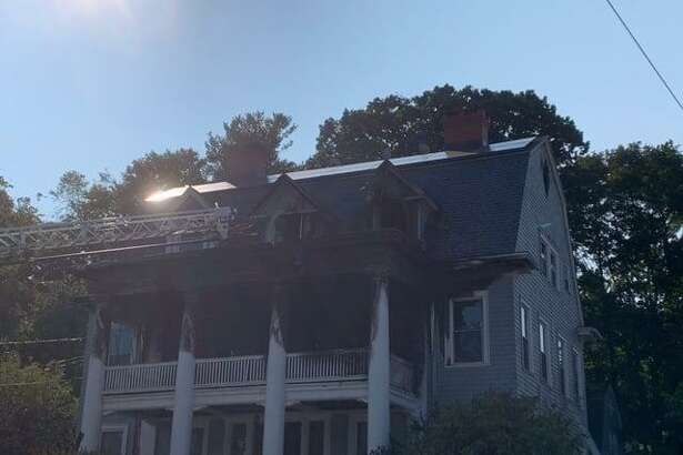 A three-story home from 1907 was damaged Monday, Sept. 21 on Hillside Avenue in Naugatuck after a fire that began on the second-floor spread to the main house and third floor. Two people were displaced by the blaze.