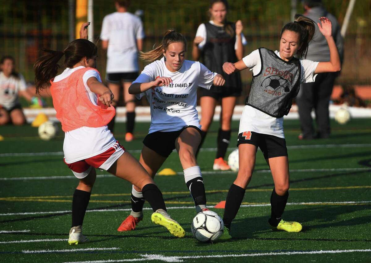 Girls varsity soccer players take the field for their first full team practice of the season at Shelton High School in Shelton, Conn. on Monday, September 21, 2020.