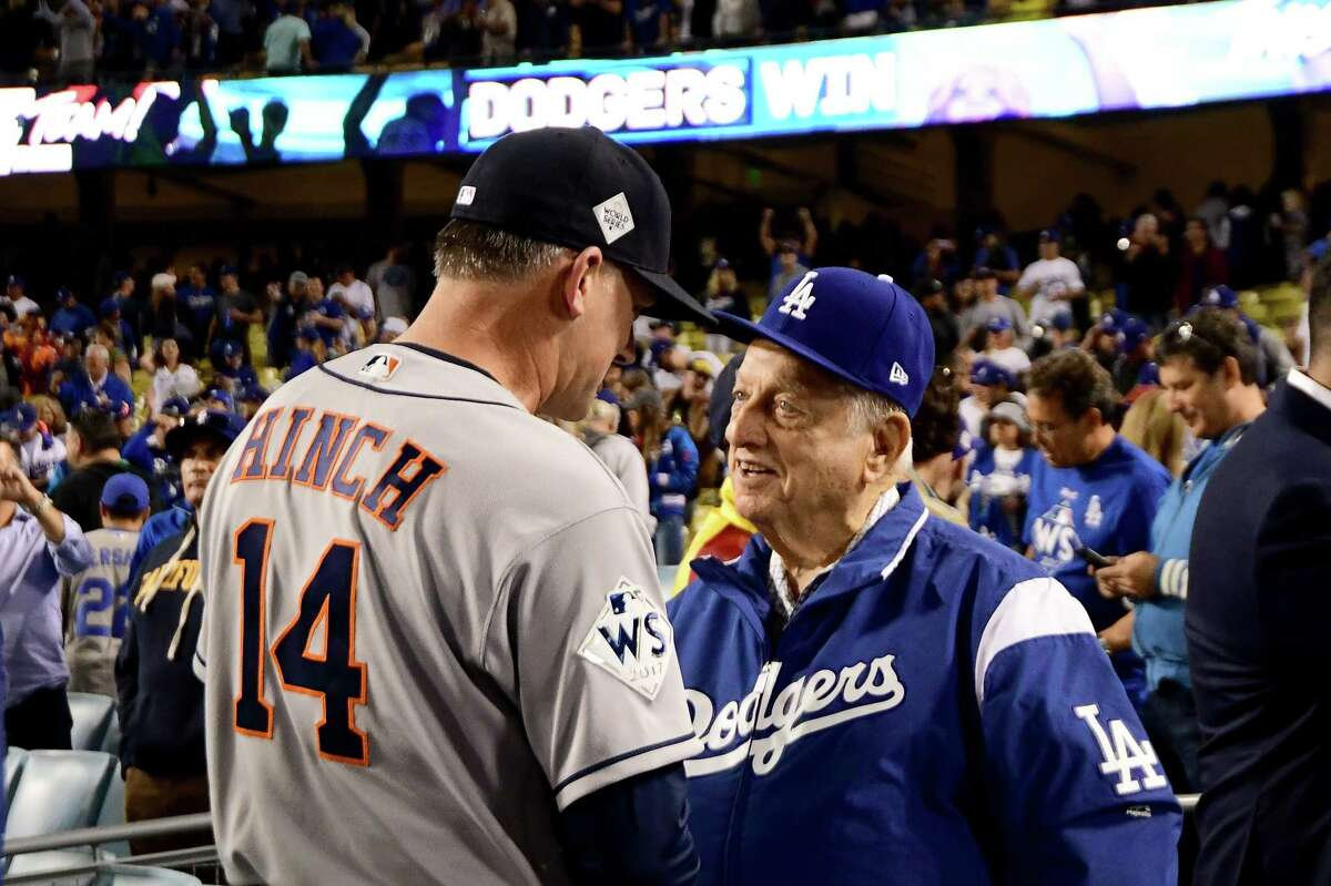 LOS ANGELES, CA - OCTOBER 31: A.J. Hinch #14 of the Houston Astros talks with former Los Angeles Dodgers manager Tommy Lasorda after game six of the 2017 World Series against the Los Angeles Dodgers at Dodger Stadium on October 31, 2017 in Los Angeles, California. (Photo by Harry How/Getty Images) ORG XMIT: 775063335