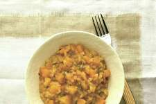 "Butternut-Rosemary Risotto (recipe in column): A creamy rice dish with a ""touch"" of autumn."