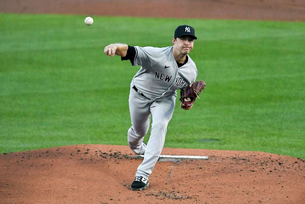 New York Yankees starting pitcher Michael King throws to a Toronto Blue Jays batter during the first inning of a baseball game in Buffalo, N.Y., Monday, Sept. 21, 2020. (AP Photo/Adrian Kraus)