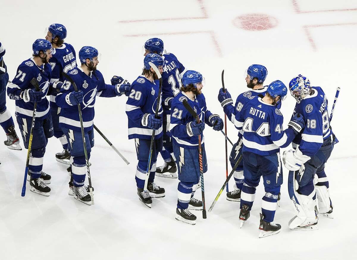 Tampa Bay Lightning players celebrate a win over the Dallas Stars in NHL Stanley Cup finals hockey action in Edmonton, Alberta, Monday, Sept. 21, 2020. (Jason Franson/The Canadian Press via AP)