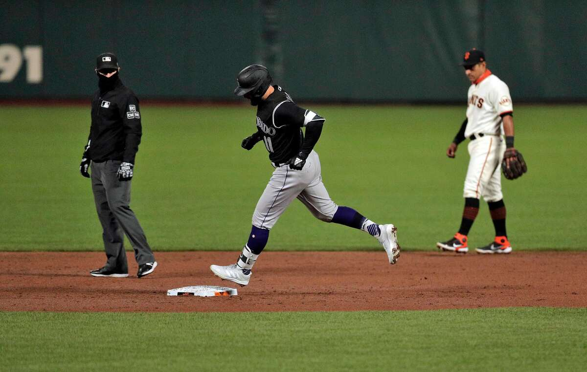 Kevin Pillar (11) rounds the bases after hitting a solo homerun in the second inning as the San Francisco Giants played the Colorado Rockies at Oracle Park in San Francisco, Calif., on Monday, September 21, 2020.