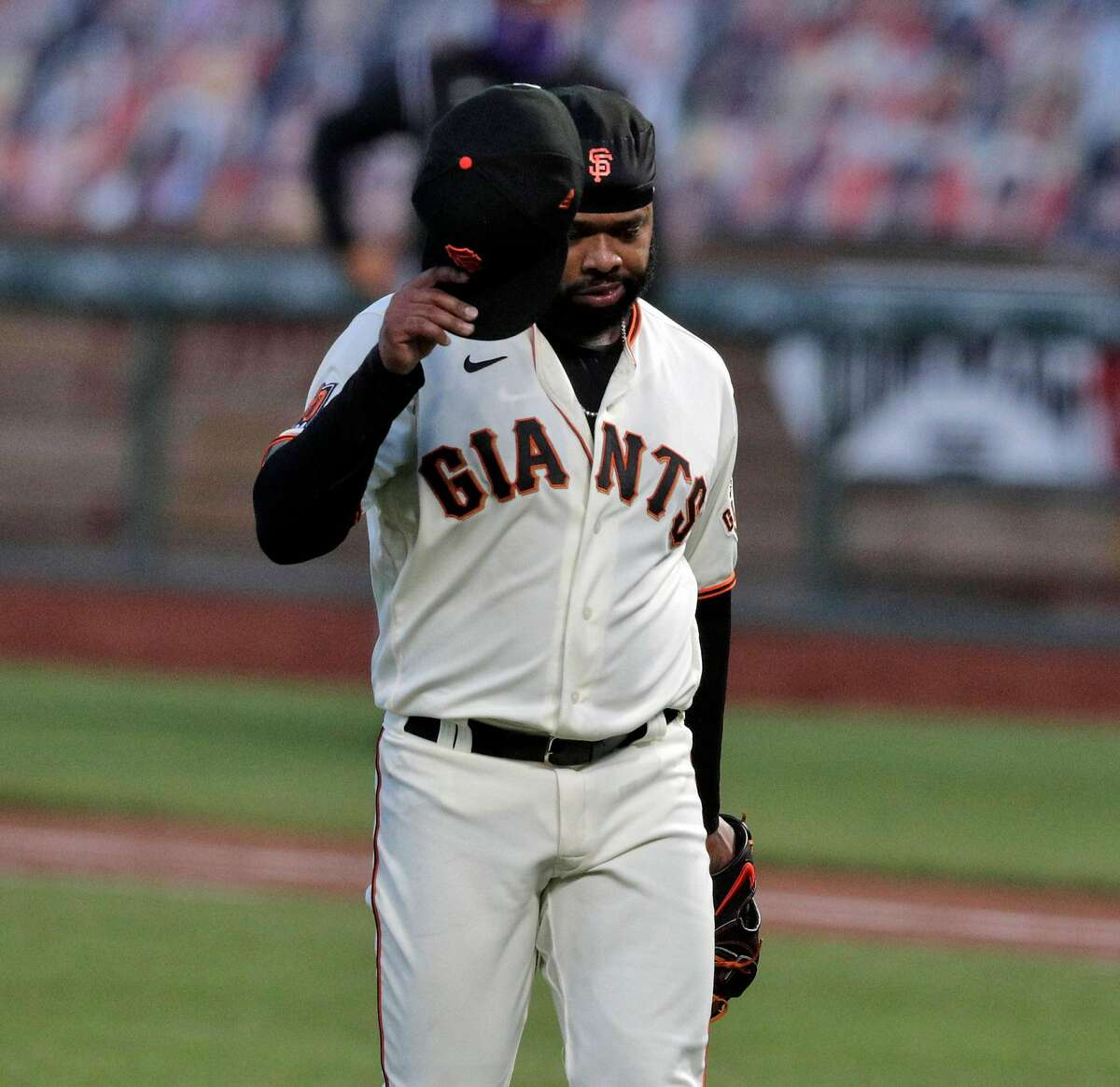 Johnny Cueto (47) walks back to the dugout after the top of the first and allowing two runs to score as the San Francisco Giants played the Colorado Rockies at Oracle Park in San Francisco, Calif., on Monday, September 21, 2020.