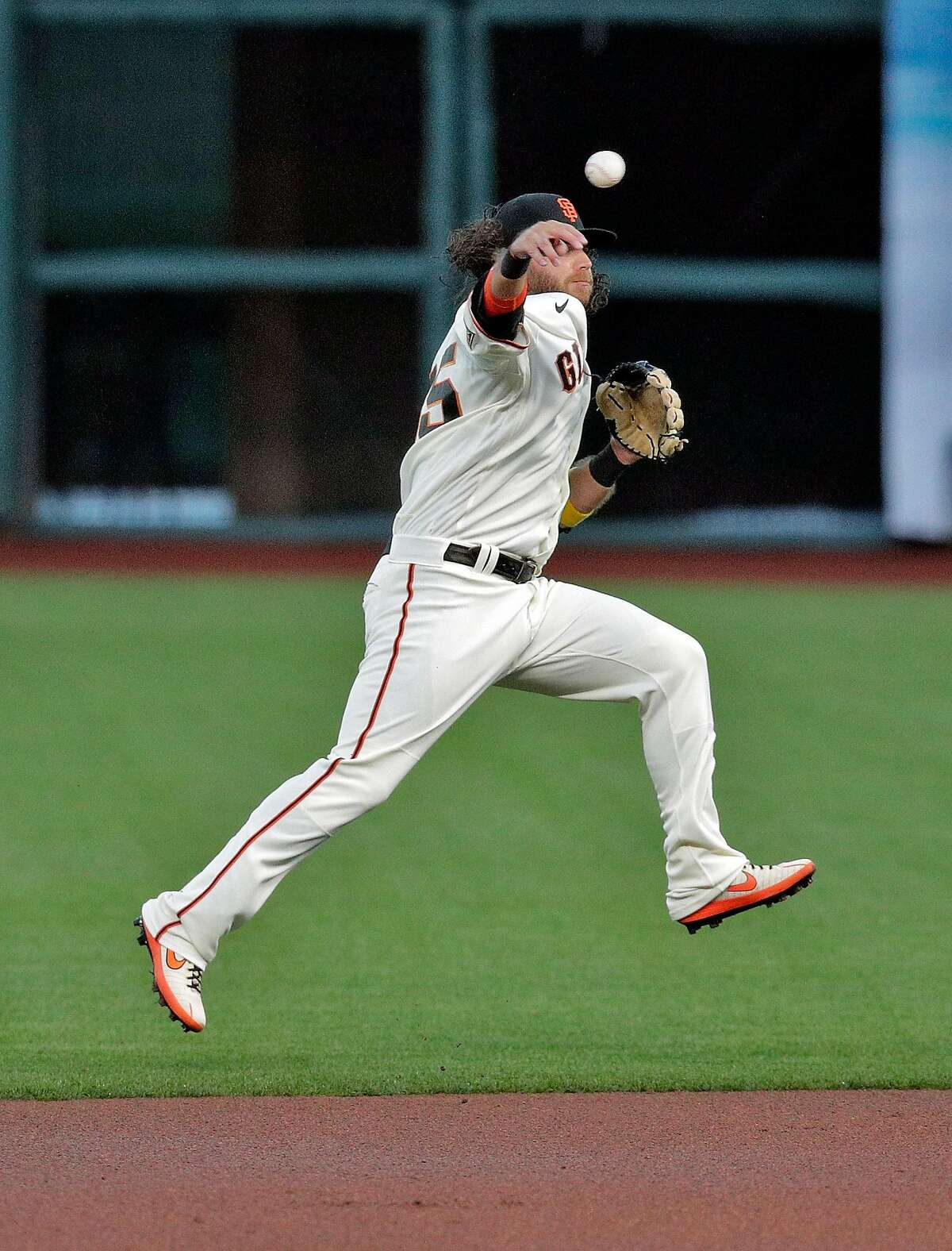 Brandon Crawford (35) pivots and throws to first to get Elias Diaz (35) at first base in the first inning as the San Francisco Giants played the Colorado Rockies at Oracle Park in San Francisco, Calif., on Monday, September 21, 2020.
