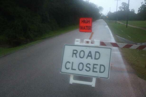 A barricade on Hammer Street in Seabrook Monday night warns motorists of high water due to the growing presence of Tropical Storm Beta.