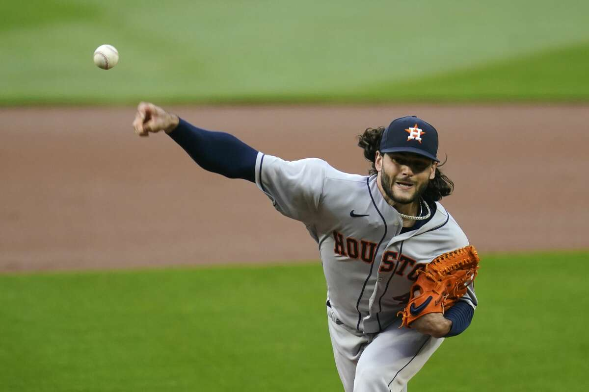 Houston Astros starting pitcher Lance McCullers Jr. throws against the Seattle Mariners in the first inning of a baseball game Monday, Sept. 21, 2020, in Seattle. (AP Photo/Elaine Thompson)