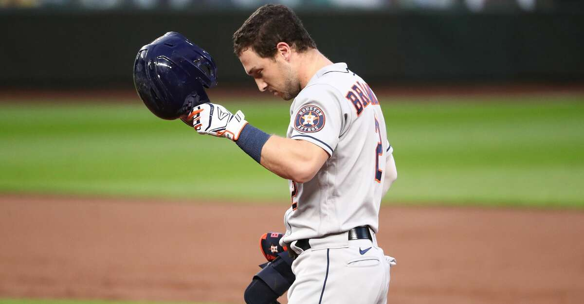 Alex Bregman #2 of the Houston Astros reacts after hitting a fly out in the third inning against the Seattle Mariners at T-Mobile Park on September 21, 2020 in Seattle, Washington. (Photo by Abbie Parr/Getty Images)