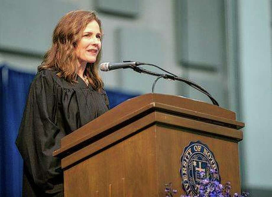Amy Coney Barrett, United States Court of Appeals for the Seventh Circuit judge, speaks May 19, 2018, during the University of Notre Dame's Law School commencement ceremony at the university in South Bend, Indiana. Barrett, a front-runner to fill the Supreme Court seat vacated by the death of Justice Ruth Bader Ginsburg, has established herself as a reliable conservative on hot-button legal issues from abortion to gun control. Photo: Robert Franklin   South Bend Tribune Via AP