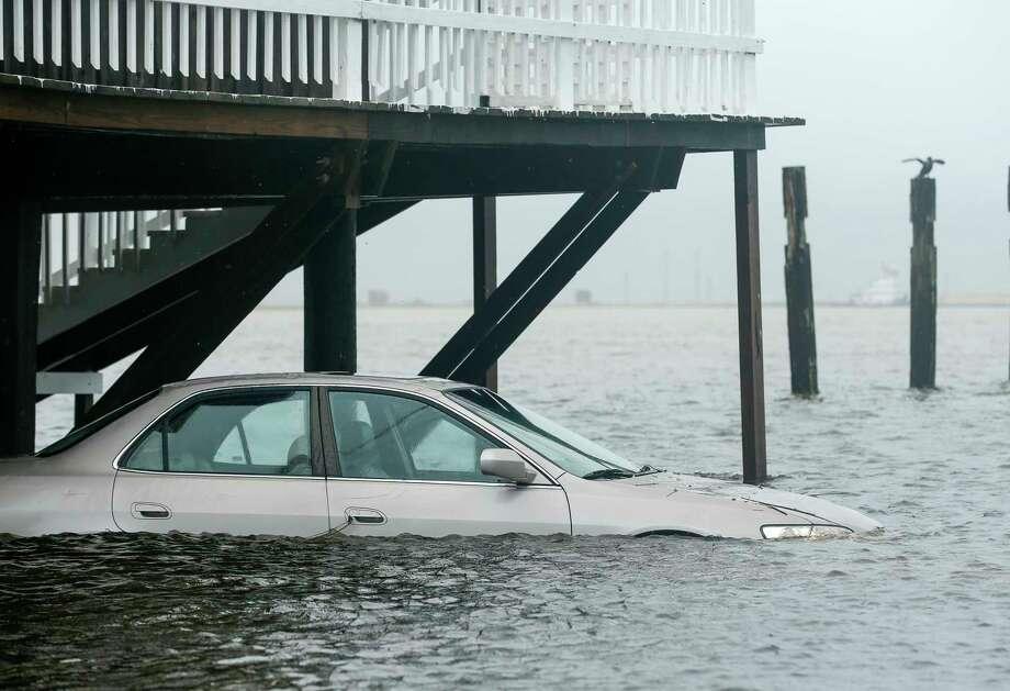 A tidal surge hit Surfside, Texas, ahead of Tropical Storm Beta making landfall Monday, Sept. 21, 2020. (Godofredo A. Vásquez/Houston Chronicle via AP) Photo: Godofredo A. Vásquez, AP / © 2020 Houston Chronicle