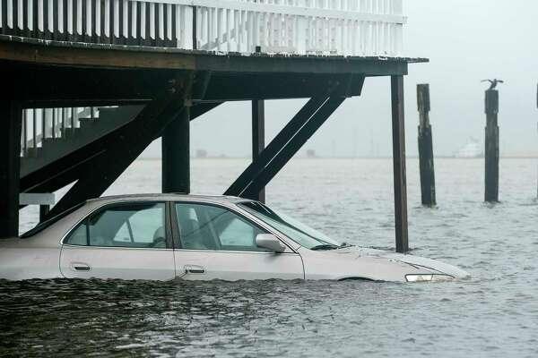 A tidal surge hit Surfside, Texas, ahead of Tropical Storm Beta making landfall Monday, Sept. 21, 2020. (Godofredo A. Vásquez/Houston Chronicle via AP)
