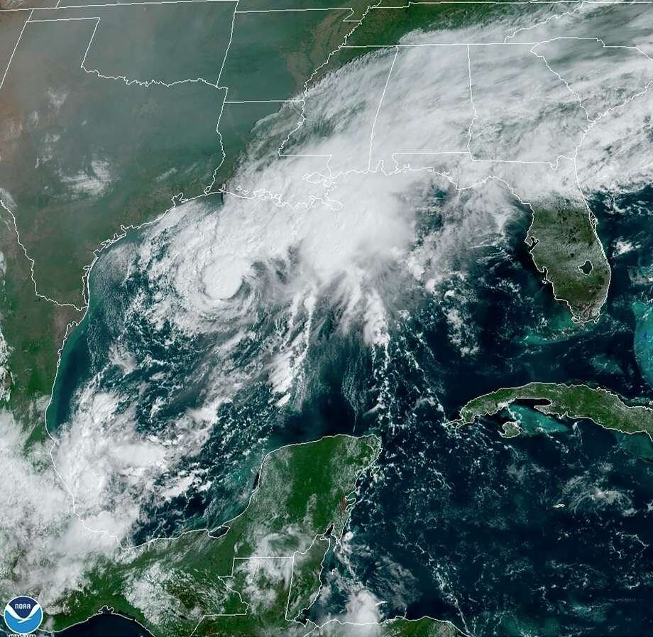 In this file image, a GOES-16 GeoColor satellite image taken Saturday, Sept. 19, 2020, and provided by NOAA, shows Tropical Storm Beta, center, in the Gulf of Mexico. A hurricane watch is in effect Saturday for coastal Texas as Tropical Storm Beta gains strength. A storm surge watch and a tropical storm watch are also in effect for the area during an exceptionally busy Atlantic hurricane season. (NOAA via AP) Photo: Associated Press / NOAA