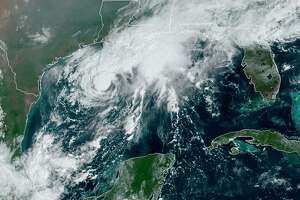 In this file image, a GOES-16 GeoColor satellite image taken Saturday, Sept. 19, 2020, and provided by NOAA, shows Tropical Storm Beta, center, in the Gulf of Mexico. A hurricane watch is in effect Saturday for coastal Texas as Tropical Storm Beta gains strength. A storm surge watch and a tropical storm watch are also in effect for the area during an exceptionally busy Atlantic hurricane season. (NOAA via AP)
