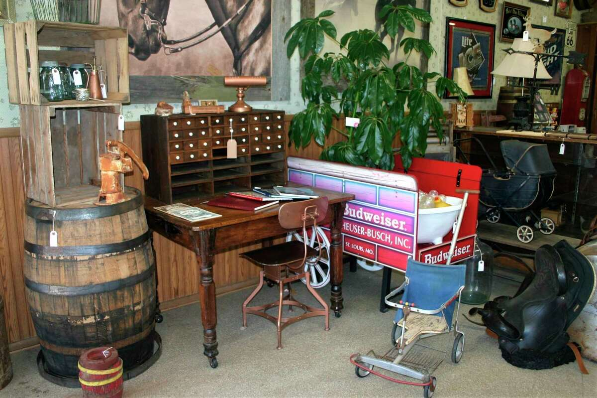 Rusty Gold Antiques in downtown Evart opened July 2, and carries an eclectic mix of furniture, dishes, knick-knacks and other items. (Herald Review photo/Cathie Crew)