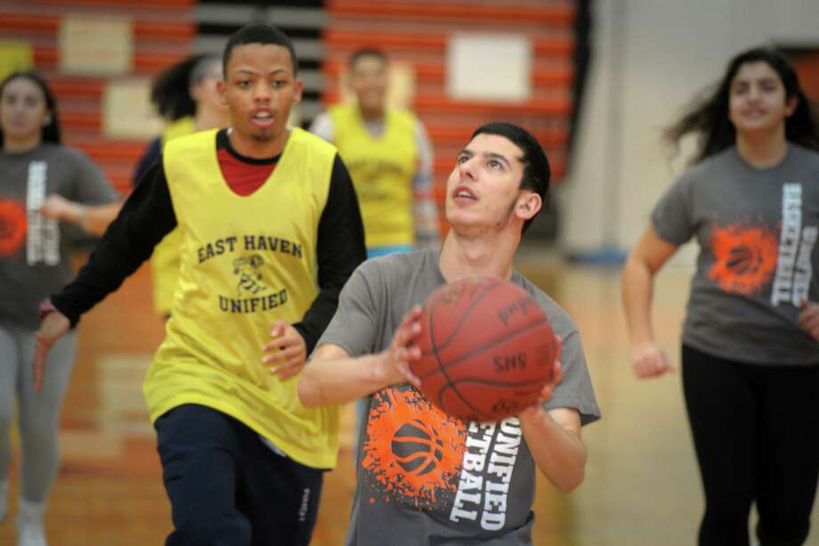 Michael Ciambrello participates in the unified sports basketball game against East Haven High School in Shelton on Feb. 18, 2020. Photo: Ned Gerard / Hearst Connecticut Media / Connecticut Post