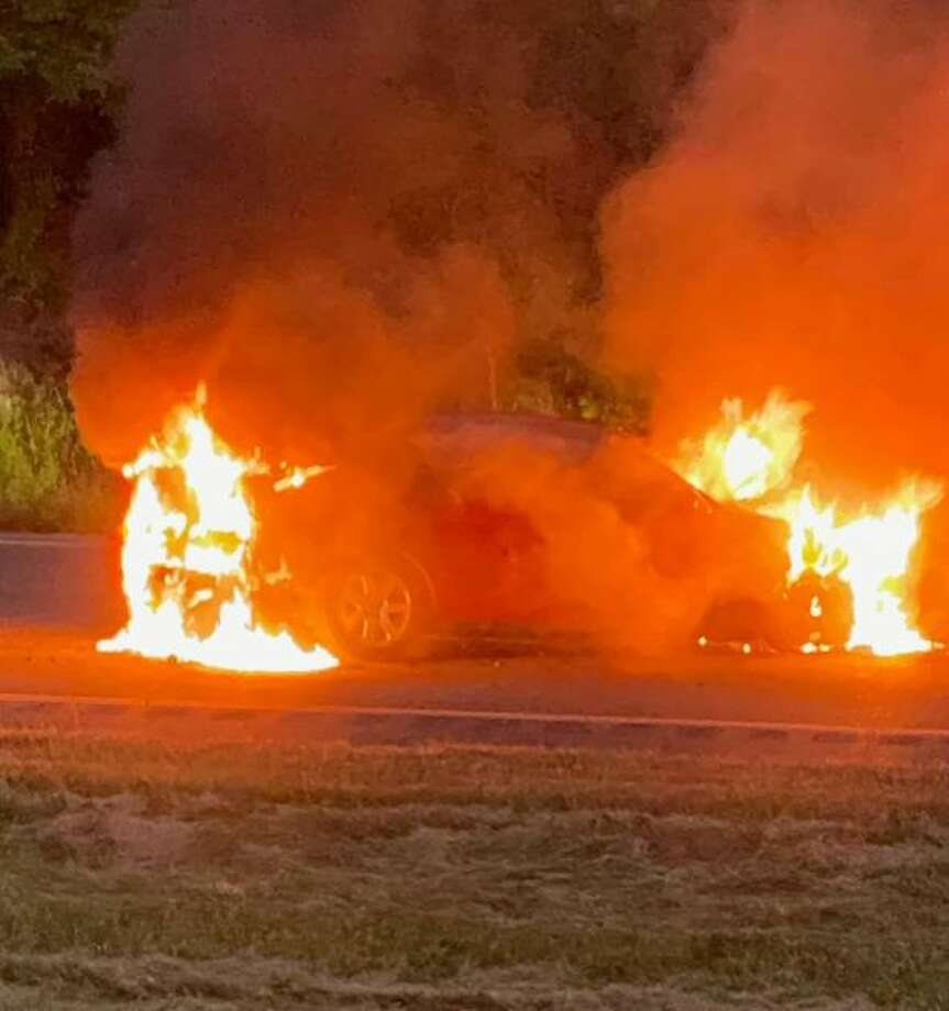 Shelton firefighters quickly extinguished a car fire Monday, Sept. 21, on Route 8 northbound. Photo: Shelton Fire Department / Contributed Photo / Connecticut Post