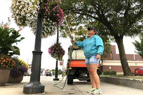 Up bright and early, Carla Wheeler spends her mornings watering the many flower baskets spread throughout the city of Big Rapids. Tuesday morning, the first official day of fall, was no different for Wheeler - a Big Rapids city worker - as she spent eight hours making sure the upkeep of the city's flowers was top notch.