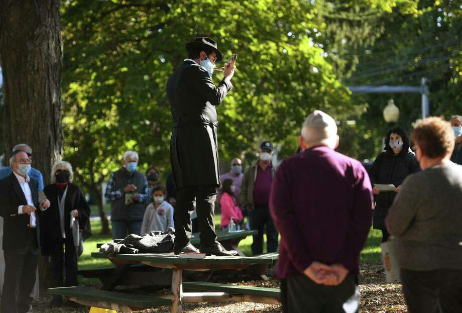 Rabbi Schneur Brook from Chabad of Shelton-Monroe blows the shofar during an outdoor Rosh Hashanah service on the Huntington Green in Shelton on Sunday. Photo: Brian A. Pounds / Hearst Connecticut Media / Connecticut Post