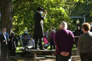 Rabbi Schneur Brook from Chabad of Shelton-Monroe blows the shofar during an outdoor Rosh Hashanah service on the Huntington Green in Shelton on Sunday.