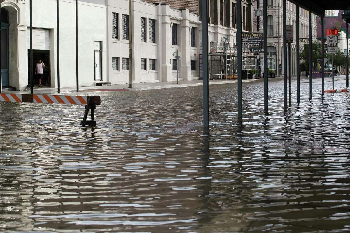 Water fills the street in The Strand from the tidal surge of Tropical Storm Beta in The Strand as the storm moves toward landfall Tuesday, Sept. 22, 2020 in Galveston.