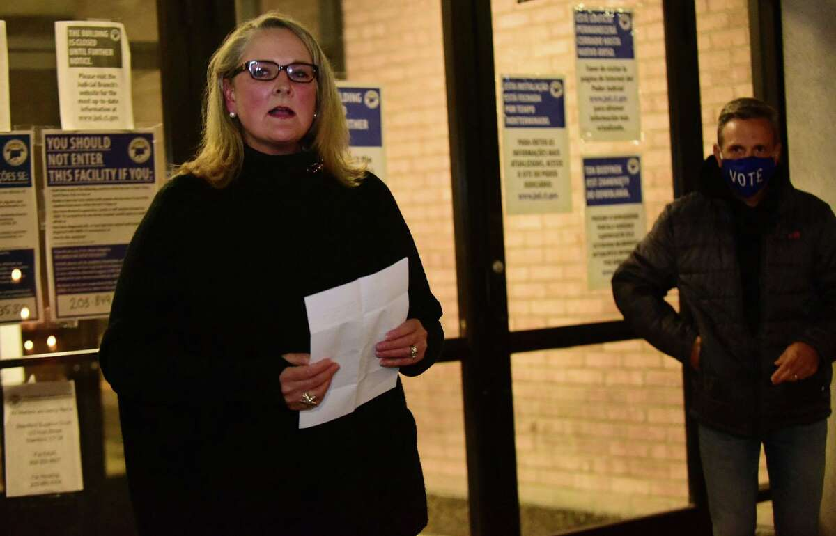 Organizer Kara Baeley addresses supporters of Supreme Court Justice Ruth Bader Ginsberg as they gather outside Norwalk Superior Court Saturday, September 19, 2020, in Norwalk, Conn. Ginsberg died Friday which opens up a vacancy on the court.