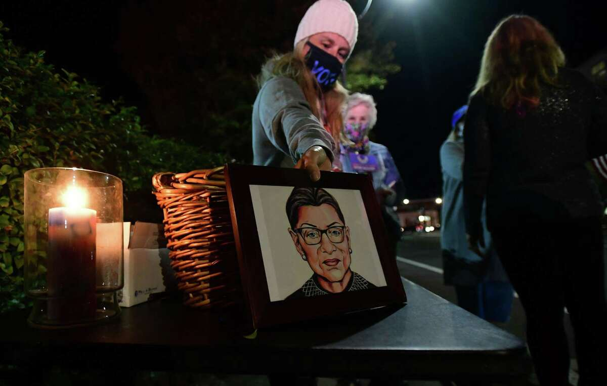 Supporters of Supreme Court Justice Ruth Bader Ginsberg gather outside Norwalk Superior Court Saturday, September 19, 2020, in Norwalk, Conn. Ginsberg died Friday which opens up a vacancy on the court.