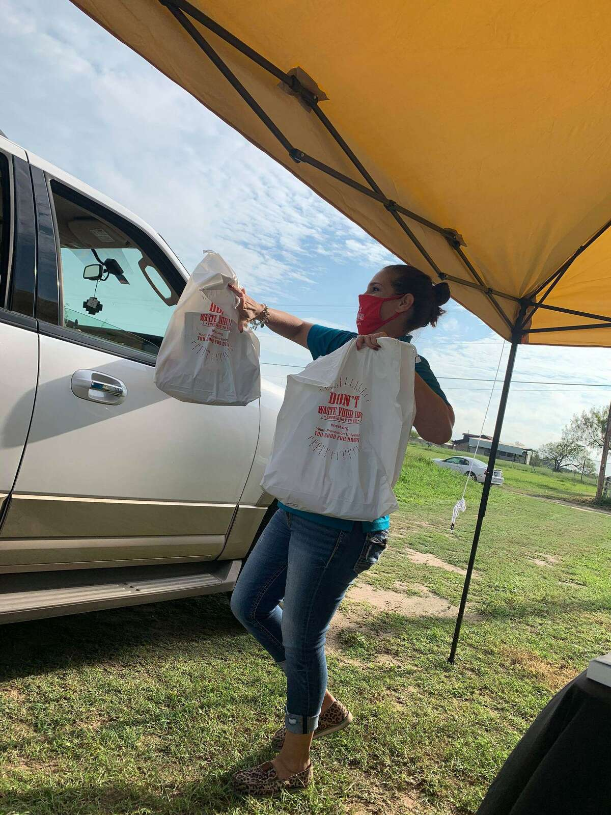 Donations from Behavioral Health Solutions of South Texas are handed to a resident of Hebbronville.