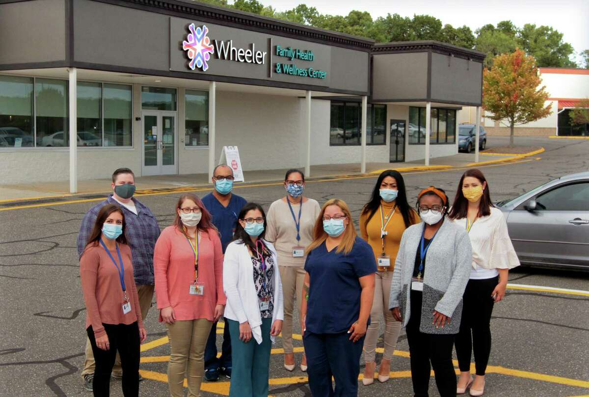 Wheeler Family Health and Wellness Center staff in front of the facility in Waterbury. From left to right is Dana Ferri, Stephanie Carroll, Wascar Gonzalez, Katherine Giannini, Alicia Rosa, Mary Colburn, Johanna Echevarria, Niyajia Walker, Jodi Gray, and Kim Holyst.