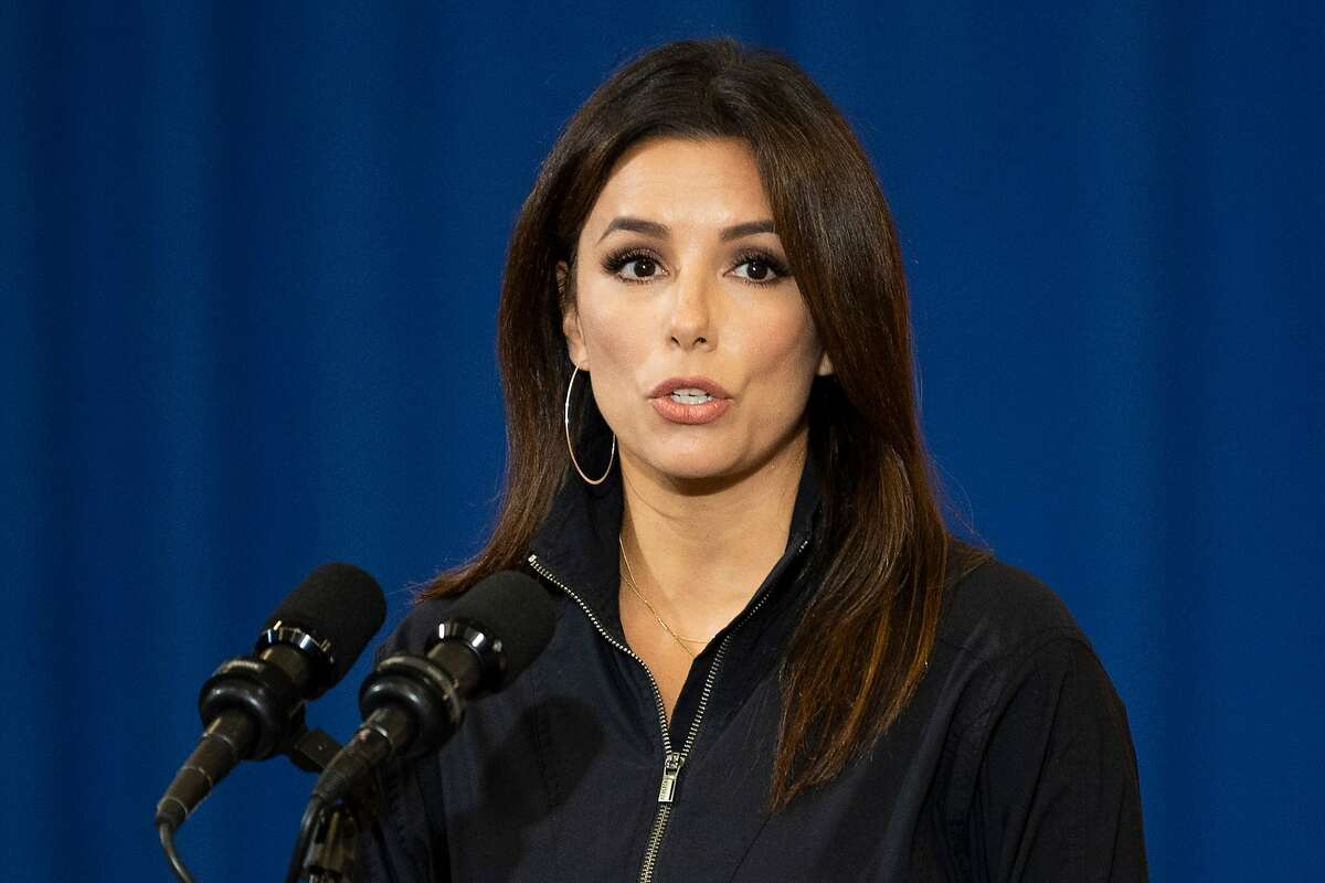 Eva Longoria, actress, activist, and Co-Founder of Latino Victory, speaks before Democratic Presidential Candidate Joe Biden as they participate in a Hispanic Heritage Month event at the Osceola Heritage Park in Kissimmee, Florida on September 15, 2020. (Photo by JIM WATSON / AFP) (Photo by JIM WATSON/AFP via Getty Images)