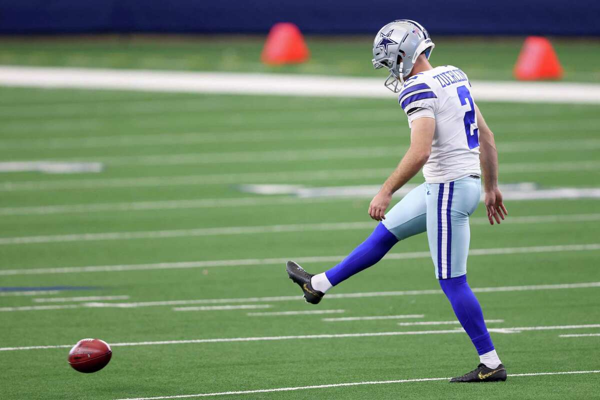 Greg Zuerlein kicks an onside kick against the Falcons in the fourth quarter Sunday at AT&T Stadium.