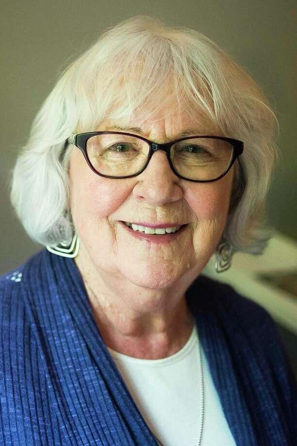 Sharon Capriccioso, a retired Blessed Sacrament teacher, poses for a portrait inside her Midland home. (Katy Kildee/kkildee@mdn.net)