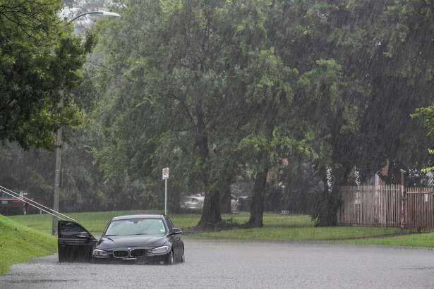Car gets stock in a pocket of flood water at Ennis St. at N MacGregor Way near Brays Bayou during Tropical Storm Beta, Tuesday, Sept. 22, 2020, in Houston.