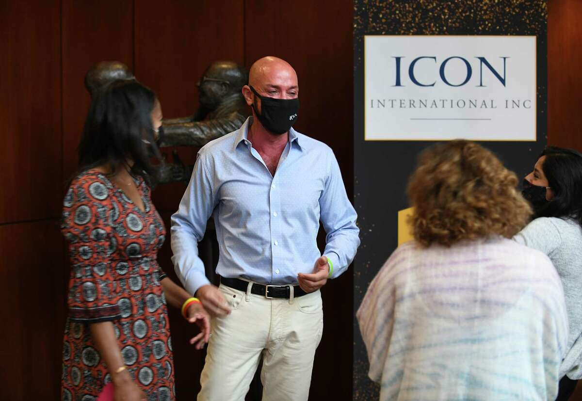 ICON International Executive Vice President of Operations Richard Upton chats with coworkers at the company's headquarters in Greenwich, Conn. Wednesday, Sept. 16, 2020. The specialized finance company focuses on corporate barter transactions.