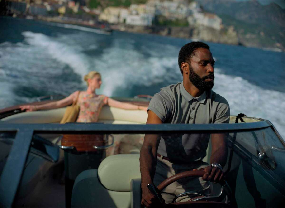 """This image released by Warner Bros. Entertainment shows Elizabeth Debicki and John David Washington in a scene from """"Tenet."""""""