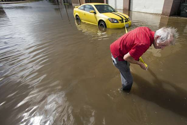 Hamilton Maschio prepares his flooded out car to be towed after it stalled in floodwaters from Tropical Storm Beta Tuesday, Sept. 22, 2020 in Galveston.
