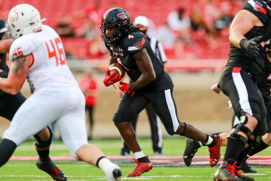 LUBBOCK, TEXAS - SEPTEMBER 12: Running back SaRodorick Thompson #4 of the Texas Tech Red Raiders runs the ball during the first half of the college football game against the Houston Baptist Huskies on September 12, 2020 at Jones AT&T Stadium in Lubbock, Texas. (Photo by John E. Moore III/Getty Images) Photo: John E. Moore III/Getty Images / 2020 John E. Moore III