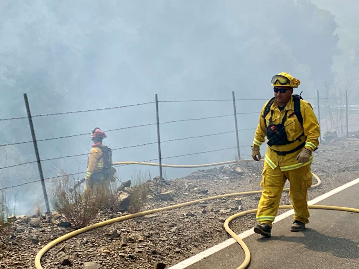 Volunteer firefighters from the Rutherford station in Napa County fight the Hennessey Fire in August 2020.