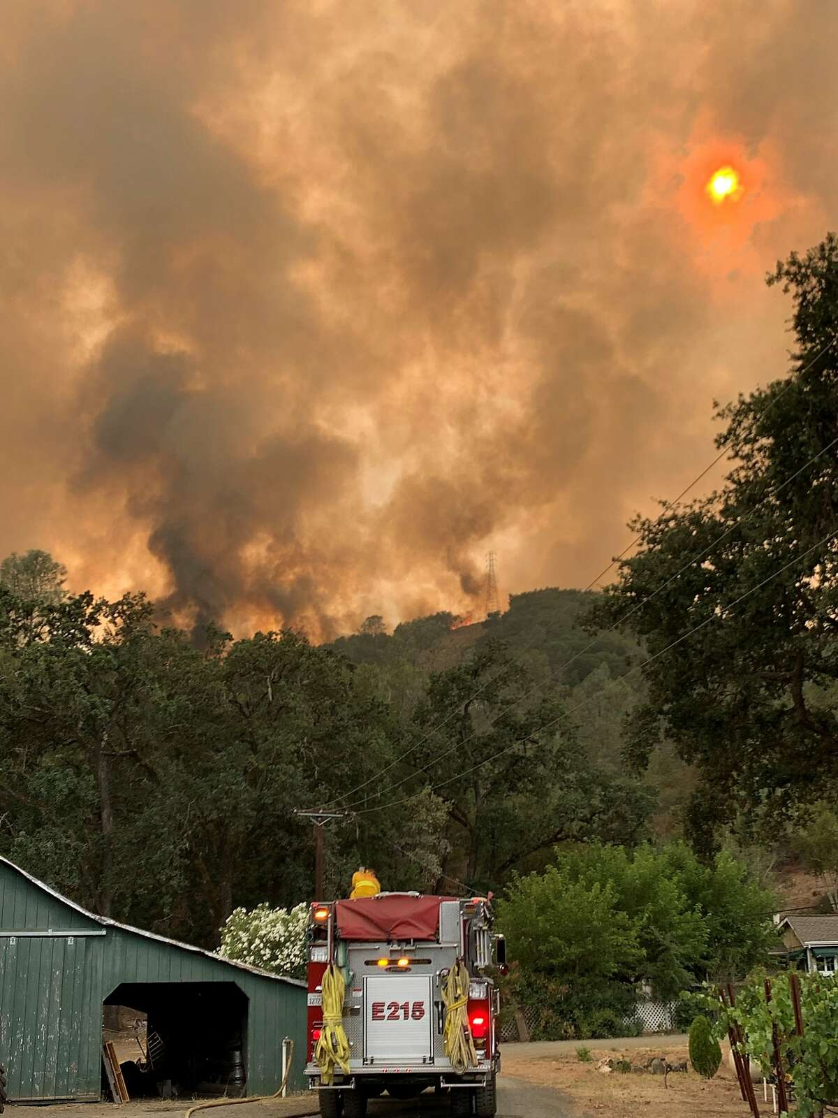 Volunteer firefighters from Napa County's Station 15 fight the Hennessey Fire in August 2020.
