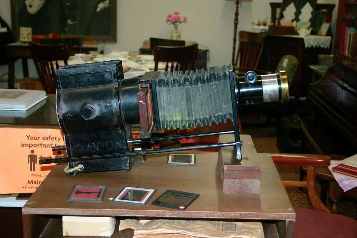 This 1800s vintage stereopticon camera is used as part of the guided tour at The Old Rugged Cross Museum in Reed City. It was owned and used by the Reverend George Bennard during his revival meetings. ( Pioneer photo/Cathie Crew)