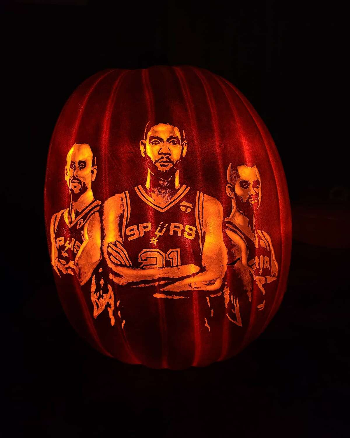 For the past five years, Arthur Alaquinez has created jazzed up jack-o'-lanterns, usually of the Spurs or Selena. This year he reunited the Spurs Big Three on a pumpkin in four hours, a personal best for him.