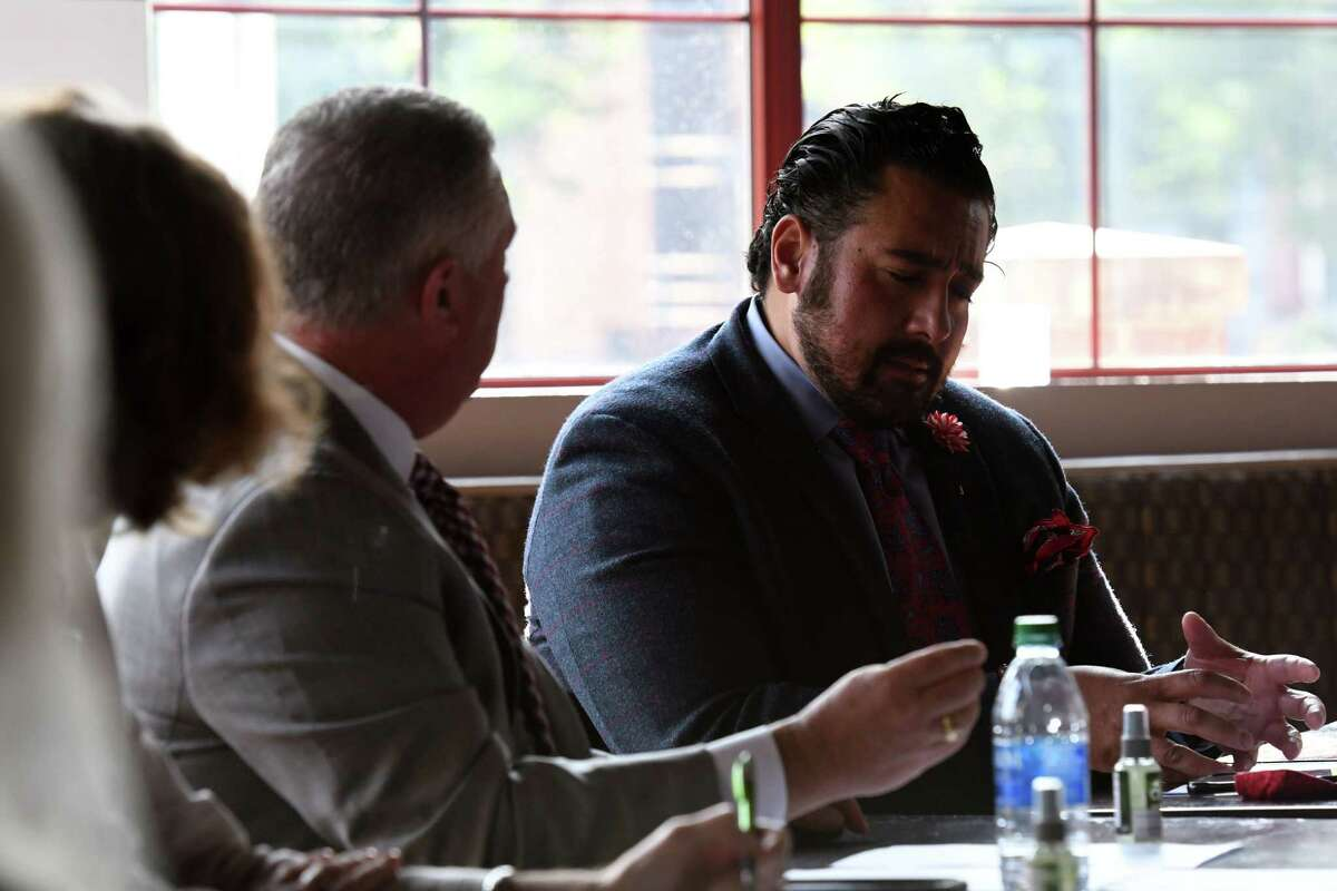 Assemblymembers Patricia Fahy, left, and John McDonald, center, listen to Dominick Purnomo, owner of Yono's/dp: An American Brasserie, right, during a roundtable discussion on the challenges area restaurants are facing through the coronavirus pandemic on Tuesday, Sept. 22, 2020, at Yono's in Albany, N.Y. It was among the first stops on the Assembly members' monthlong tour of restaurants throughout the Capital Region to get a sense of challenges restaurants are facing and what shared solutions can be brought forward to help keep their doors open. (Will Waldron/Times Union)
