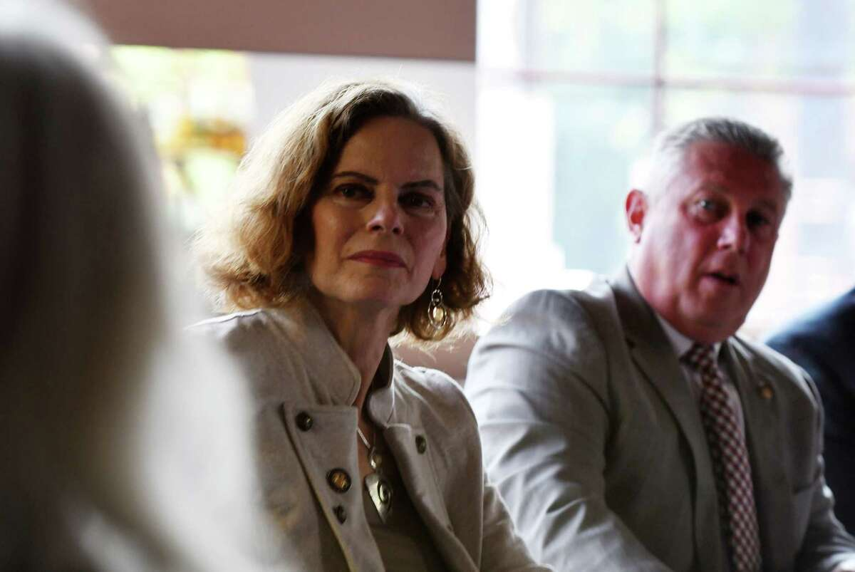 Assemblymembers Patricia Fahy, left, and John McDonald, right, listen to local restaurant owners during a roundtable discussion on the challenges area restaurants are facing through the coronavirus pandemic on Tuesday, Sept. 22, 2020, at Yono's, dp An American Brasserie, in Albany, N.Y. It was among the first stops on the Assembly members' monthlong tour of restaurants throughout the Capital Region to get a sense of challenges restaurants are facing and what shared solutions can be brought forward to help keep their doors open. (Will Waldron/Times Union)