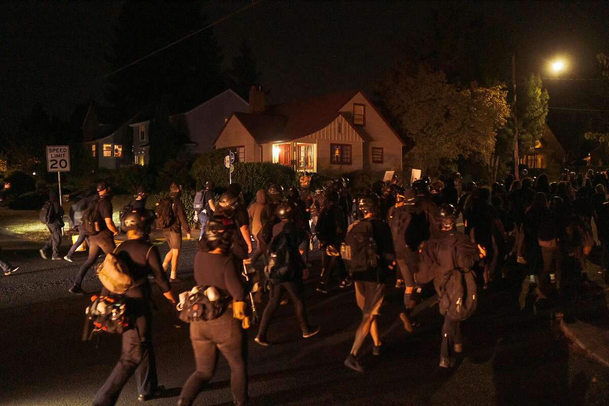 Protesters march through a residential area in Portland, Ore., on Sept. 3, 2020. Protesters have argued that not enough has changed quickly enough to prevent and punish police misconduct. (Mason Trinca/The New York Times)