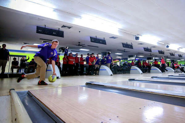 Roxana High bowlers take part in a dual prep action at Airport Plaza Bowl during a previous season in Bethalto. Area high school bowling teams will begin practice in November for their winter schedule, but their school's athletic directors are working with area bowling alleys on their schedules, which because of COVID-19 regulations, limits capacity.
