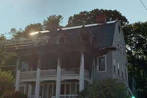 A porch fire on Hillside Avenue in Naugatuck, Conn., on Monday, Sept. 21, 2020, quickly spread to the second and third floors, according to the fire department.