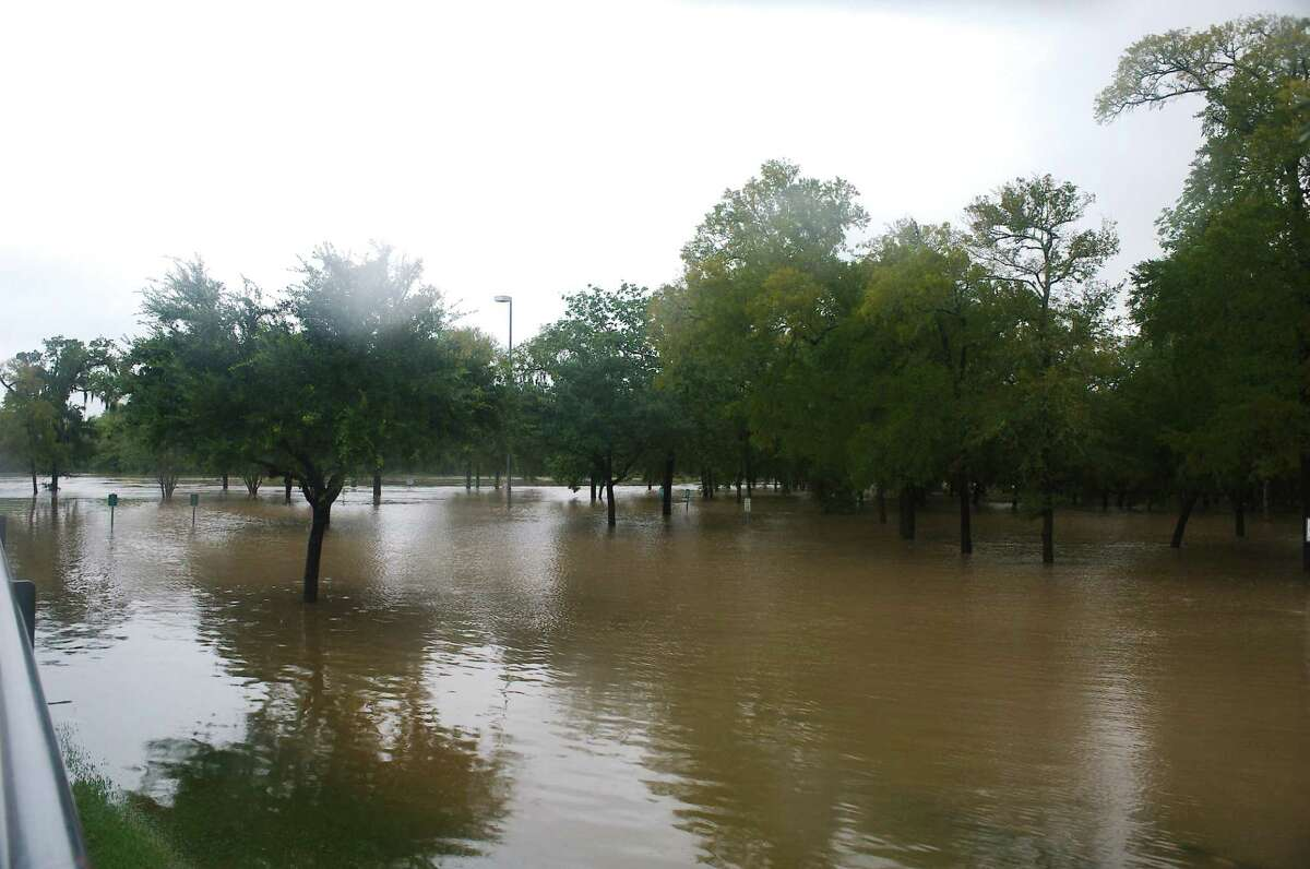Clear Creek flows out of its banks at Countryside Park off Bay Area Boulevard in League City.