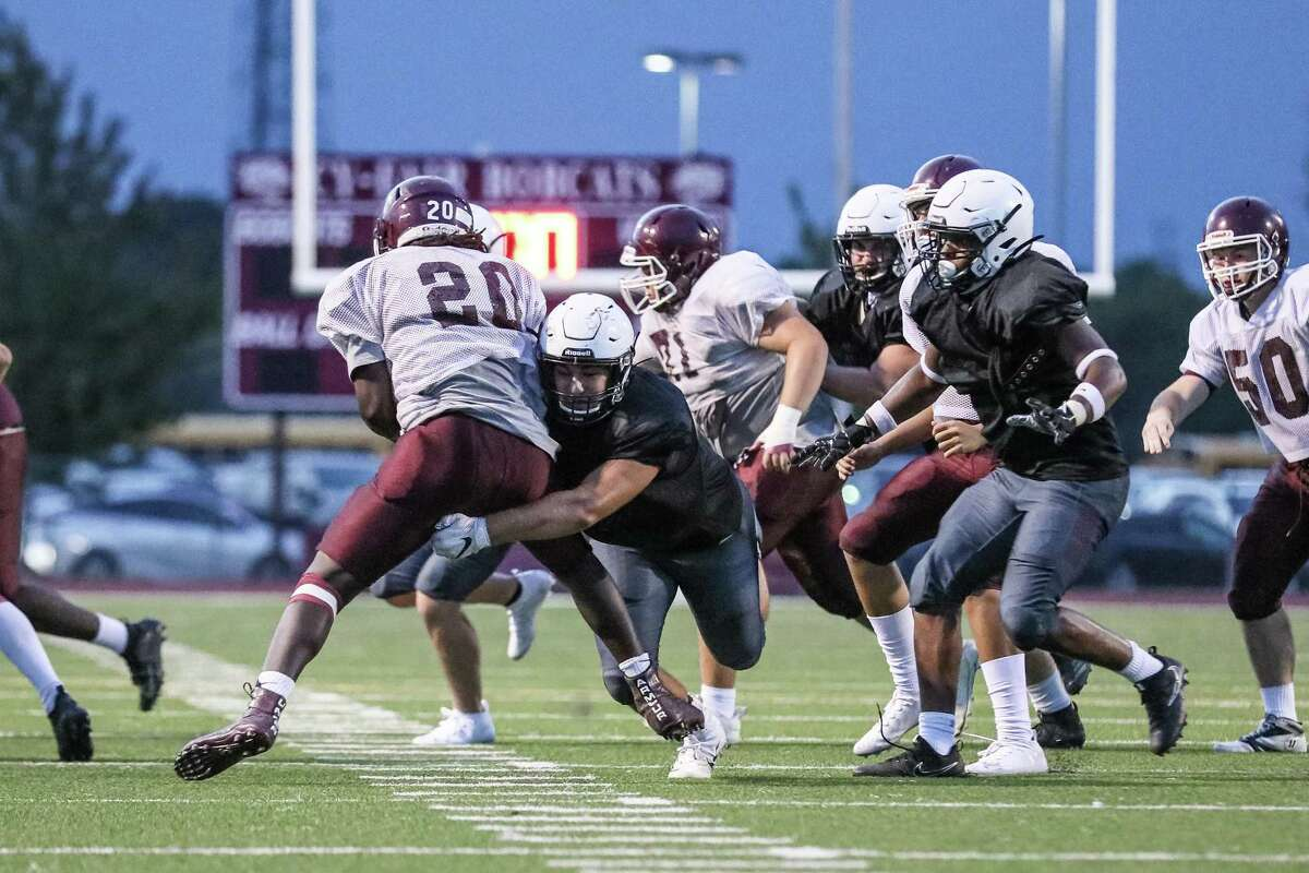 Pearland's defense (dark uniforms) will have a stern test against The Woodlands this week as it did in last week's scrimmage (shown here) against Cy Fair.