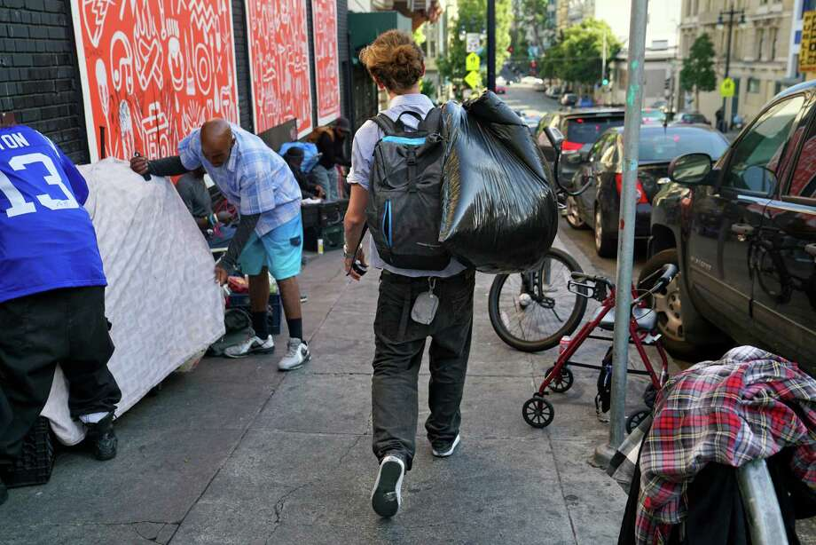 Will Andrews, a homeless man struggling with drug addiction, carries belongings in a garbage bag while making his way down Jones St. toward Eddy. Photo: Guy Wathen / The Chronicle / **MANDATORY CREDIT FOR PHOTOG AND SF CHRONICLE/NO SALES/MAGS OUT/TV