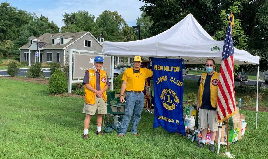 Lions, from left to right, Mike Wilcox, Mike Sennello and Matt Roach proudly collect supplies for the drive. Photo: Courtesy Of New Milford Lions Club / Danbury News Times Contributed